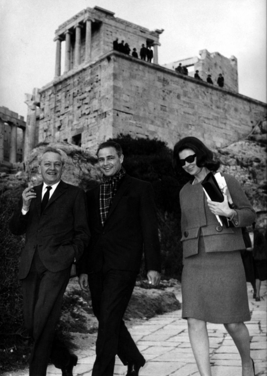 circa 1958: American film star Marlon Brando visits the Acropolis in Athens with exiled Hollywood director Jules Dassin. Behind them rises the gateway or Propylaea. (Photo by Keystone/Getty Images)
