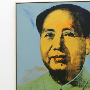 """BERLIN - MARCH 28:  A visitor looks at the painting """"Mao"""" by Andy Warhol at the Hamburger Bahnhof Contemporary Art Museum March 28, 2007 in Berlin, Germany. The painting is part of a collection that includes other Warhols, as well as works by Roy Lichtenstein and Joseph Beuys and is on loan from art collector Erich Marx. Marx is threatening to pull the entire collection from the museum because he feels the museum is not giving it the attention it deserves.  (Photo by Sean Gallup/Getty Images)"""