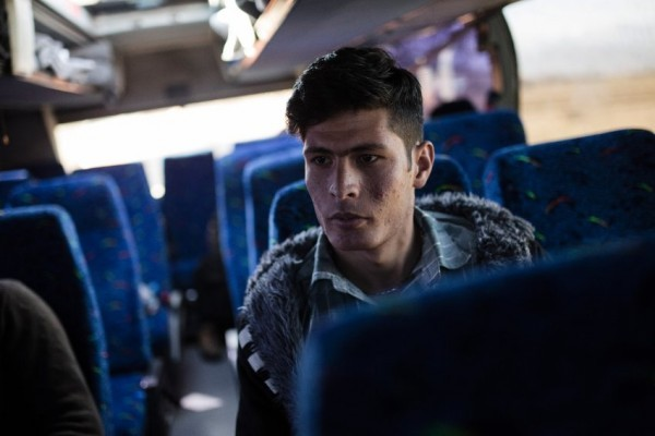 Mukhtar (18) from Afghanistan following the interview waits inside a bus, in Idomeni, Greece on Feb.2, 2016.