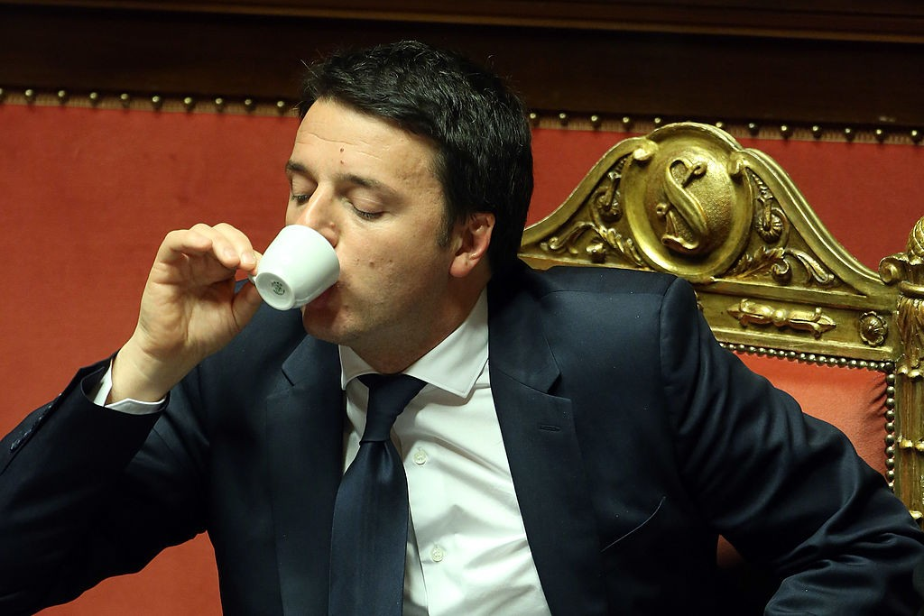 ROME, ITALY - FEBRUARY 24: Italian Prime Minister Matteo Renzi drinks an expresso coffe as he attends a debate ahead of a confidence vote for his coalition government at the Italian Senate Palazzo Madama on February 24, 2014 in Rome, Italy. Renzi, 39, is the youngest prime minister in the country's history. (Photo by Franco Origlia/Getty Images)
