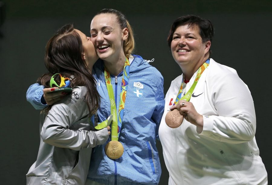 2016 Rio Olympics - Shooting - Victory Ceremony - Women's 25m Pistol Victory Ceremony - Olympic Shooting Centre - Rio de Janeiro, Brazil - 09/08/2016. (L-R) Monika Karsch (GER) of Germany, Anna Korakaki (GRE) of Greece, Heidi Diethelm Gerber (SUI) of Switzerland celebrate with their medals. REUTERS/Edgard Garrido FOR EDITORIAL USE ONLY. NOT FOR SALE FOR MARKETING OR ADVERTISING CAMPAIGNS.