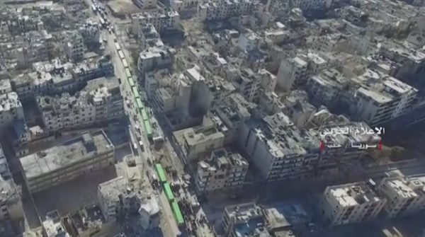 A still image from video taken December 15, 2016 over eastern Aleppo shows an operation to evacuate thousands of civilians and fighters in buses from Aleppo, Syria. Syrian Army/Handout via Reuters TV