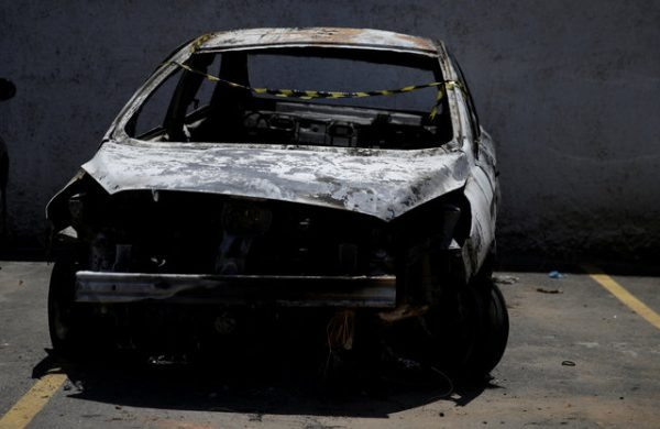 A burned car in which a body was found during searches for the Greek Ambassador for Brazil Kyriakos Amiridis, is pictured at a police station in Belford Roxo, Brazil December 30, 2016. REUTERS/Ricardo Moraes