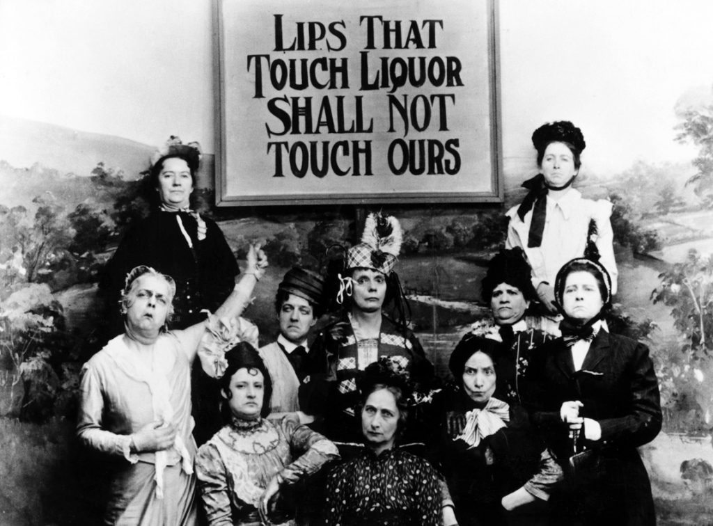 Lips That Touch Liquor Shall Not Touch Ours, satirical photograph of teetotaller women, still from c. 1890s movie filmed in Edison's Black Maria studio