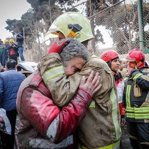 Firefighters react at the site of a collapsed high-rise building in Tehran, Iran January 19, 2017. Tasnim News Agency/Handout via REUTERS ATTENTION EDITORS - THIS PICTURE WAS PROVIDED BY A THIRD PARTY. FOR EDITORIAL USE ONLY. NO RESALES. NO ARCHIVE.