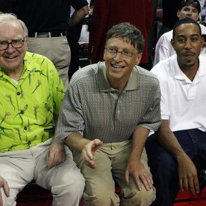 LAS VEGAS - JULY 25: (L-R) Warren Buffett, Bill Gates and rapper Ludacris sit courtside during the 2008 State Farm Basketball Challenge exhibition game between the USA Basketball Men's Senior National Team and the Canadian Senior Men's National Team at the Thomas & Mack Center July 25, 2008 in Las Vegas, Nevada. (Photo by Ethan Miller/Getty Images)