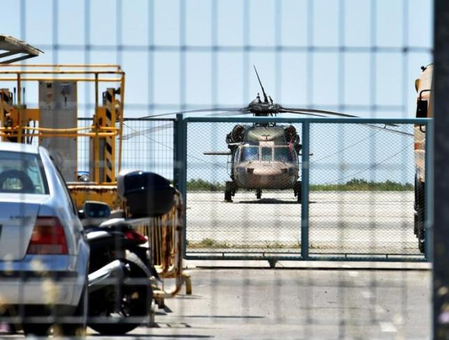 A Turkish military helicopter lands in the northern Greek city of Alexandroupolis with eight men on board who have requested political asylum after the attempted coup in Turkey, July 16, 2016. Eurokinissi/Panagiota Tsikaki/via REUTERS