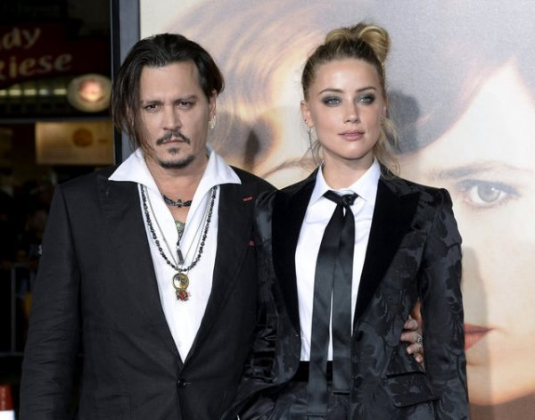 """FILE PHOTO -- Cast member Amber Heard and husband Johnny Depp pose during the premiere of the film """"The Danish Girl,"""" in Los Angeles, California November 21, 2015. REUTERS/Kevork Djansezian/File Photo"""