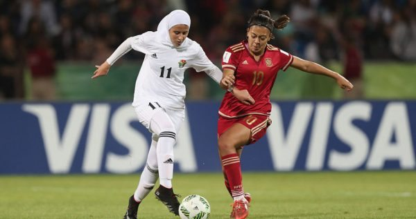 AMMAN, JORDAN - SEPTEMBER 30: Tasneem Abu-Rob ofJordan battles with Paula Fernandez of Spain during the FIFA U-17 Women's World Cup Jordan 2016 Group A match between Jordan and Spain at Amman International Stadium on September 30, 2016 in Amman, Jordan. (Photo by Christopher Lee - FIFA/FIFA via Getty Images)