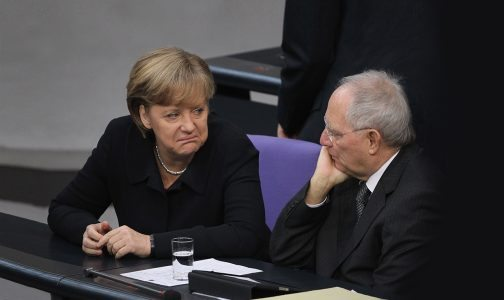 BERLIN, GERMANY - DECEMBER 02:  German Chancellor Angela Merkel and Finance Minister Wolfgang Schaeuble attend debates at the Bundestag after she gave a government declaration on the Euro and the current Eurozone debt crisis on December 2, 2011 in Berlin, Germany. Merkel is urging changes to financial regulations within the Eurozone and said recovery from the current crisis is a long-term process.  (Photo by Sean Gallup/Getty Images)