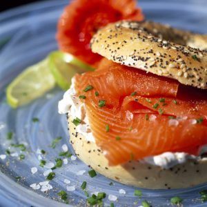 Smoked Salmon and Cream Cheese in a Seeded Fresh Sliced Bagel, healthy eating, for breakfast, lunch, brunch, snack, healthy option food, isolated against a white plain background, clipping path, cut out