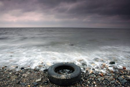 PRESTWICK, SCOTLAND - MARCH 22:  A tyres is washed up by the sea on the beaches in Prestwick, Scotland, 22 March 2005. A survey conducted by Beachwatch in September of last year, monitored 46  beaches in Scotland and a total of 250 in the UK. The main source of litter (33.4%) was from beach visitors. This was followed by sewage-related debris (26.1%), fishing debris (9.9%) and shipping (2.3%).  (Photo by Christopher Furlong/Getty Images)