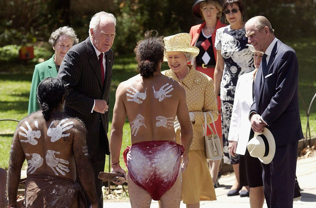 401615 02: Britains Queen Elizabeth II (2nd R), her husband Prince Philip The Duke of Edinburgh, and their representative in Australia Governor-General Peter Hollingworth (L) meet aboriginal dancers from the Paitya Dance Group during a ceremonial welcome to mark the beginning of the Royal visit to Australia, February 27, 2002 in Adelaide. (Photo Tony Lewis/ Getty Images)