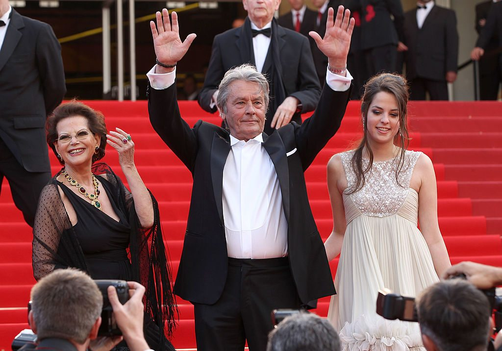 "CANNES, FRANCE - MAY 14: Actress Claudia Cardinale, actor Alain Delon and Anouchka Delon attends the ""IL Gattopardo"" Premiere at the Palais des Festivals during the 63rd Annual Cannes Film Festival on May 14, 2010 in Cannes, France. (Photo by Sean Gallup/Getty Images)"