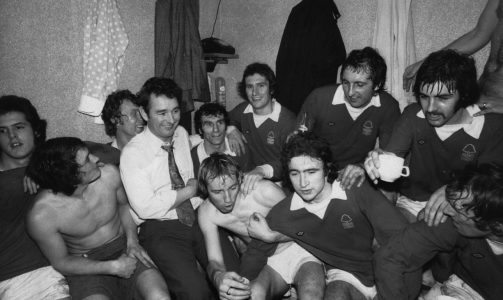 Nottingham Forest manager Brian Clough (1935 - 2004, centre, right) with his team in the dressing room after their 1-0 victory over Tottenham Hotspur in an FA Cup Third Round Replay at White Hart Lane, London, 8th January 1975. This was Clough's first game in charge as Nottingham Forest manager. (Photo by Michael Fresco/Evening Standard/Hulton Archive/Getty Images)