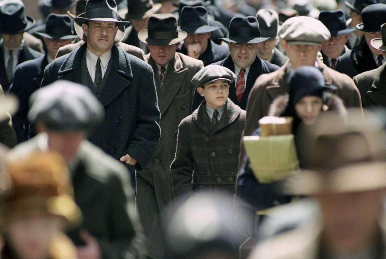 O Τομ Χανκς και ο Τάιλερ Χόκλιν στον «Δρόμο της Απώλειας» (2002) του Σαμ Μέντες. Ο ήρωας Μάικλ Σάλιβαν προσπάθησε να γλιτώσει το παιδί του από τον κόσμο του εγκλήματος