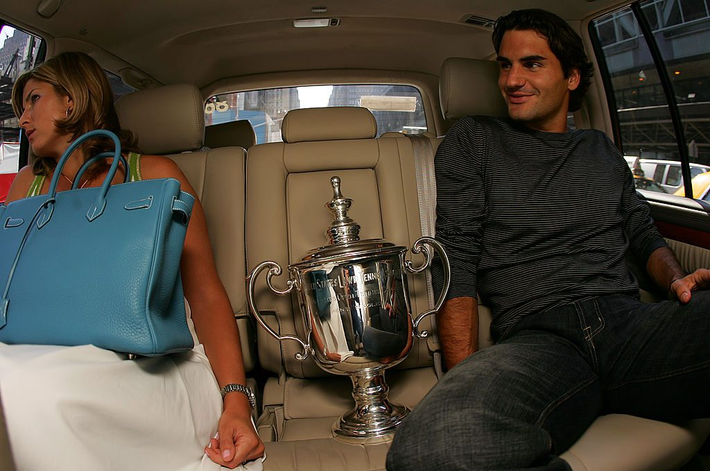 NEW YORK- SEPTEMBER 12: Roger Federer is seen in a car with his girlfriend Mirka Vavrinec as he rides to various media appearances with his US Open trophy following his victory last night in the 2005 US Open Tennis Championship September 12, 2005 in New York City. (Photo by Chris Trotman/Getty Images)