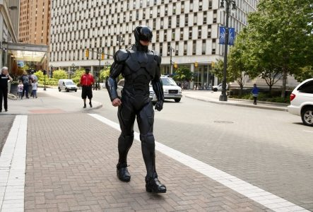 epa04238330 A man dressed as RoboCop, a character of the 2014 remake of the US science fiction film, walks down the street in Detroit, Michigan, USA, 03 June 2014. The original movie RoboCop from 1987 was based in the crime-ridden capital of Michigan. The figure promoted the DVD release that was set for 03 June. A ten-foot Robocop statue is currently being cast in bronze and is planned to be displayed in Detroit.  EPA/JEFF KOWALSKY