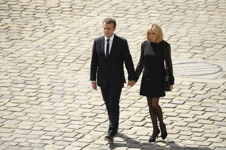 epa06067278 French President Emmanuel Macron and his wife Brigitte Trogneux leave a funeral ceremony for Simone Veil, in the courtyard of the Invalides in Paris, France, 05 July 2017. Holocaust survivors are joining France's president and European dignitaries at a special memorial ceremony for Simone Veil, who rose from the horrors of Nazi death camps to become president of the European Parliament and one of France's most revered politicians. EPA/JULIEN DE ROSA