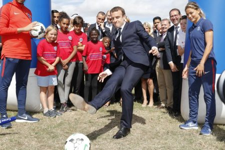 epa06122896 French President Emmanuel Macron kicks the ball as he visits the recreationnal centre for children in Moisson, France, 03 August 2017.  EPA/PHILIPPE WOJAZER / POOL MAXPPP OUT