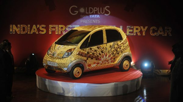 A custom Tata Motors' 'Nano' car, is seen adorned in gold, silver and gemstone trimmings during its unveiling in Mumbai on September 19, 2011. The World's first Gold jewellery car, claimed by Tata, is made from 80 kilograms of 22 karat gold, 15 kilograms of silver, and numerous gemstones. AFP PHOTO/ Punit PARANJPE (Photo credit should read PUNIT PARANJPE/AFP/Getty Images)