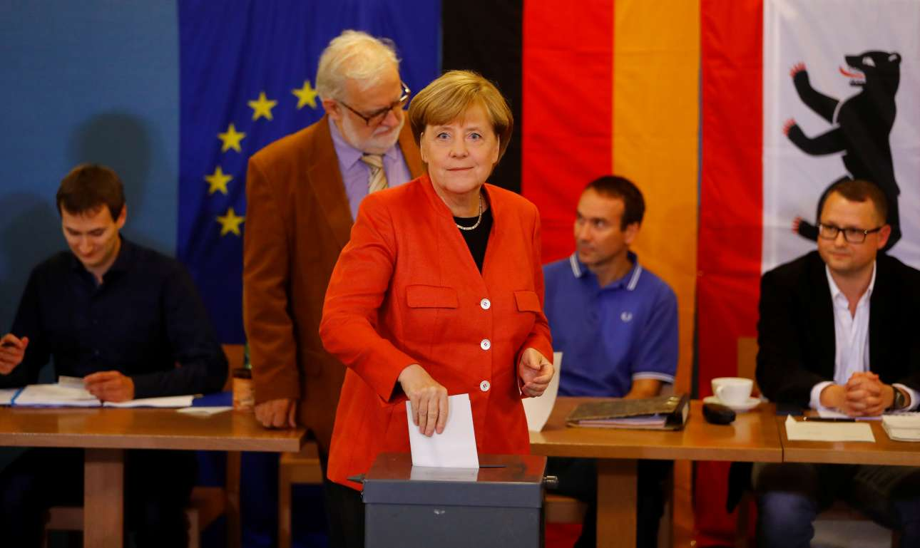 2017-09-24T125301Z_414386505_RC1416871100_RTRMADP_3_GERMANY-ELECTION-MERKEL-VOTES