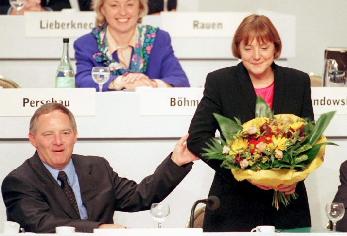 epa00549682 (FILE) The picture dated 07 November 1998 shows then-new Chairman of the Conservatives (CDU) Wolfgang Schaeuble congratulating Angela Merkel for just being elected as CDU secretary general during a CDU party convention in Bonn, Germany. For the first time ever Germany gets with Angela Merkel a female Chancellor. As being the yet youngest Head of Government she will lead the second big coalition in German history. Three weeks after the federal election, SPD and Union (i.e. CDU and CSU) agreed in the Chancellor question and at the distribution of the Ministries. Head of the Social Conservatives (CSU) Stoiber confirmed such according to dpa informations on Monday 10 October 2005. EPA/MICHAEL JUNG