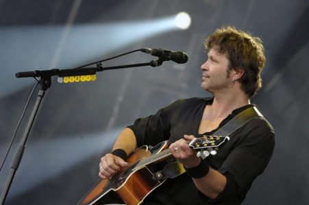 epa04323389 French singer Bertrand Cantat performs with his new band Detroit during the Vieilles Charrues Festival in Carhaix, France, 19 July 2014. The music festival runs from 17 to 20 July.  EPA/HUGO MARIE