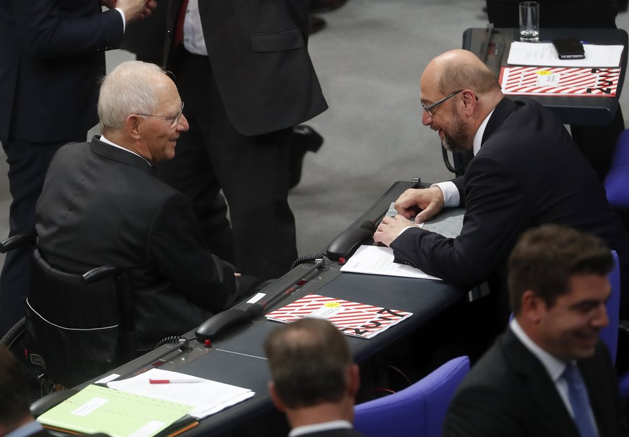 epa06285769 German Finance Minister and nominated President of the German Parliament, Wolfgang Schaeuble (L), and the leader of the Social Democratic Party (SPD), Martin Schulz (R), chat during the constituent meeting of the German 'Bundestag' parliament, in Berlin, Germany, 24 October 2017. Others are not identified. The newly elected German Bundestag holds its constituent meeting of Parliament in its 19th electoral period. The meeting will be opened with a speech by the chairman by seniority followed by the election of the President of the Bundestag and the other members of the Presidium, as well as the decision on the agenda of the German Bundestag. EPA/FELIPE TRUEBA