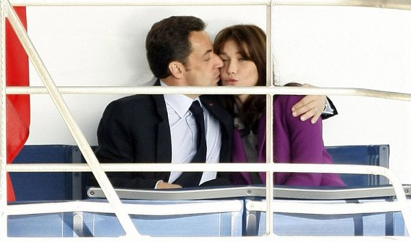 LONDON - MARCH 27: French President Nicolas Sarkozy kisses his wife Carla Bruni-Sarkozyas they sit on the back of the Clipper Aurora headed for Greenwich on March 27, 2008 in London, England. President Nicolas Sarkozy and wife Carla Bruni-Sarkozy are on a two day state visit to London and Windsor. (Photo by Daniel Berehulak/Getty Images)