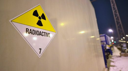 epa02497560 The Radioactivity warning sign is seen at a Castor container on a train during a stopover in Magdeburg, eastern Germany, on 16 December morning. Experts were checking the technical security of the train before it continues its journey to the temporary nuclear waste storage site in Lubmin. The transport of four so-called Castor containers with nuclear waste is expected to arrive at the site later the same day. The waste containing some 2,500 nuclear fuel rods from a German reasearch center and the nuclear powered research vessel 'Otto Hahn' has been stored at the French nuclear plant in Cadarache so far. EPA/Hendrik Schmidt