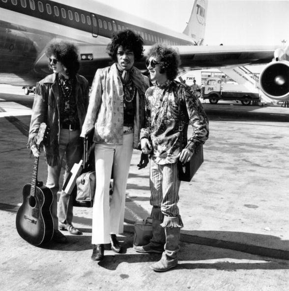 21st August 1967: Popular rock trio the Jimi Hendrix Experience at London Airport with their hand luggage. They are, from left to right; Noel Redding (1945 - 2003), bass player, Jimi Hendrix, singer, guitarist and songwriter, and Mitch Mitchell, drummer. (Photo by Express/Express/Getty Images)