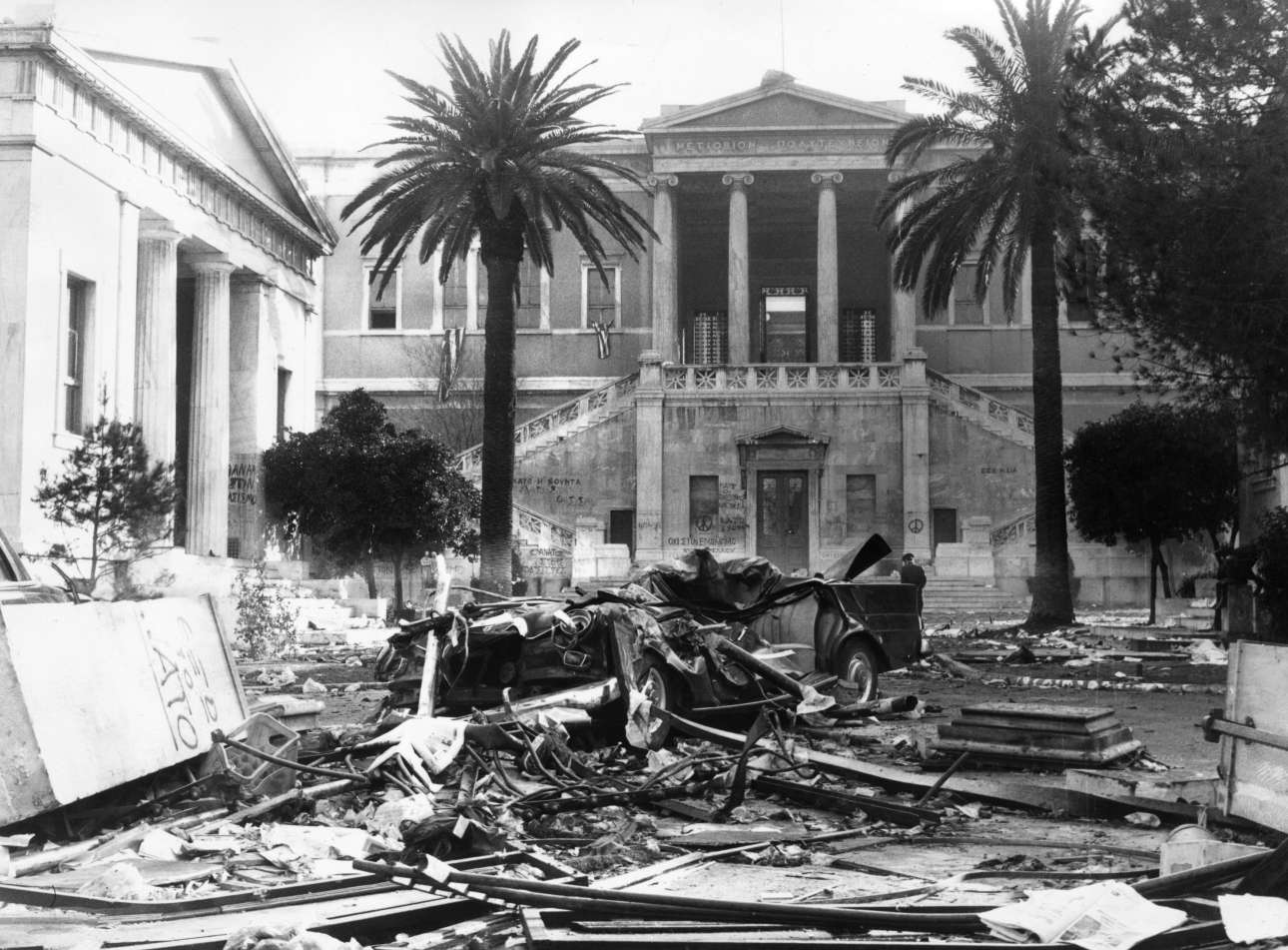 20th November 1973: Burnt-out cars, furniture and other debris in the square outside Athens Polytechnic after a night of street battles around the time of the counter-coup which ousted Papadopoulos during the regime of the Greek Colonels. (Photo by Keystone/Getty Images)