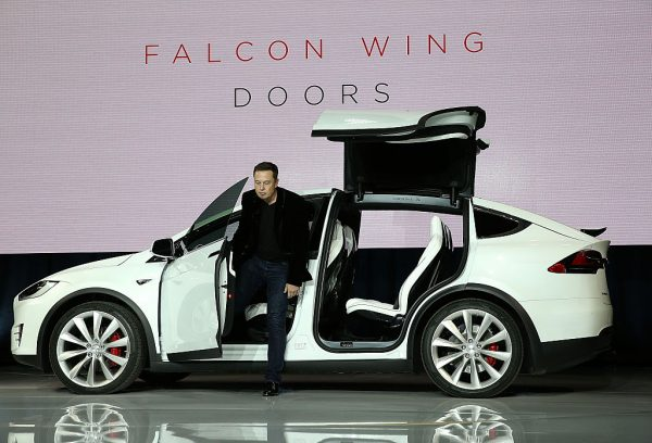 FREMONT, CA - SEPTEMBER 29: Tesla CEO Elon Musk demonstrates the falcon wing doors on the new Tesla Model X Crossover SUV during a launch event on September 29, 2015 in Fremont, California. After several production delays, Elon Musk officially launched the much anticipated Tesla Model X Crossover SUV. The (Photo by Justin Sullivan/Getty Images)