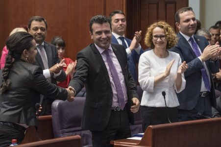 epa06002398 New Macedonian Prime Minister Zoran Zaev (C) celebrates with the members of his government after he was elected in the Macedonian parliament in Skopje, The Former Yugoslav Republic of Macedonia, 31 May 2017. Zaev plans to use his newly elected government to negotiate and ensure his country's entry into the the North Atlantic Treaty Organization (NATO) and the European Union (EU).  EPA/GEORGI LICOVSKI