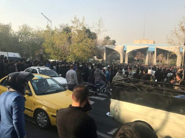 People protest near the university of Tehran, Iran December 30, 2017 in this picture obtained from social media. REUTERS. THIS IMAGE HAS BEEN SUPPLIED BY A THIRD PARTY. NO RESALES. NO ARCHIVES