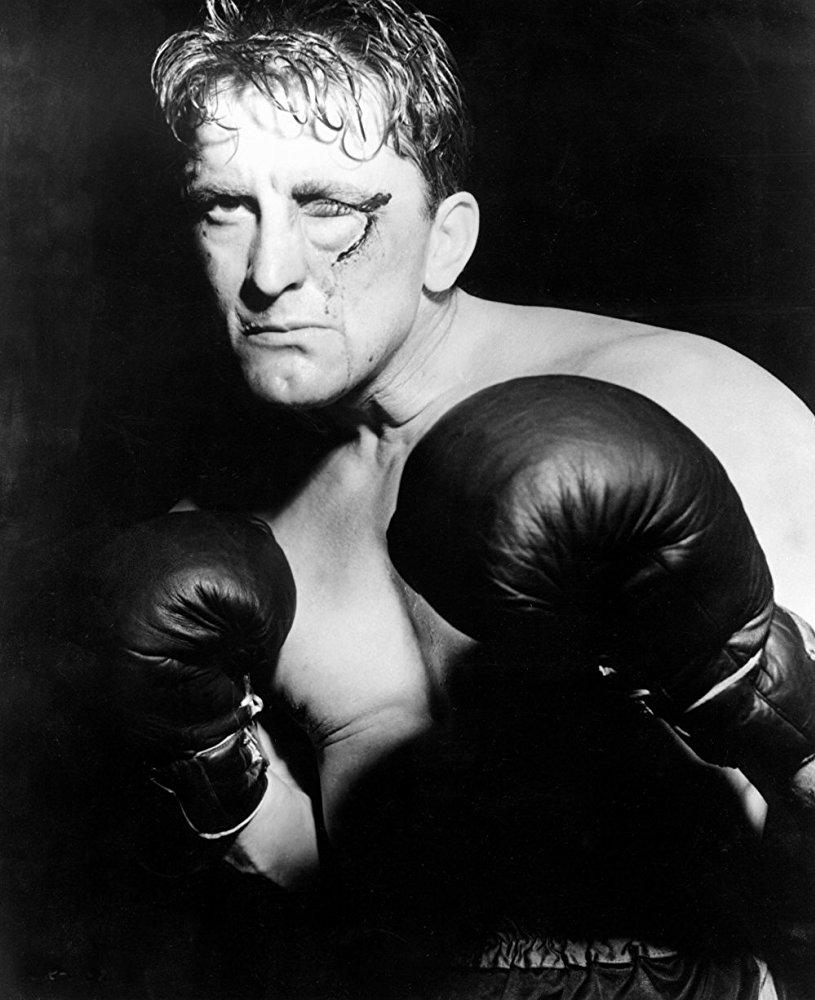 Ως ο αδίστακτος μποξέρ Μιντζ Κέλι στην ταινία «Πρωταθλητής», το1949