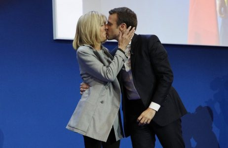 epa05924528 French presidential election candidate for the 'En Marche!' (Onwards!) political movement, Emmanuel Macron (R) kisses his wife his wife Brigitte Trogneux (L) after the first round of the French presidential elections in Paris, France, 23 April 2017. Media reports that polling agencies projections place Macron and far-right Front National (FN) party candidate Marine Le-Pen in the lead positions for the vote. France will hold the second round of the presidential elections on 07 May 2017.  EPA/YOAN VALAT