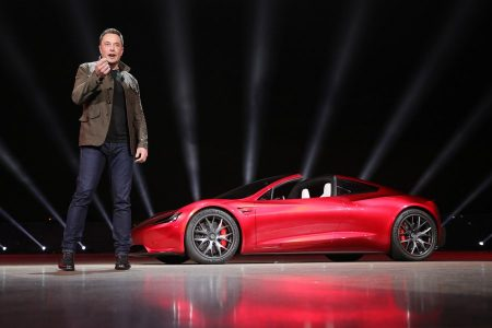epa06335606 A handout photo made available by Tesla 16 November 2017, showing Tesla founder Elon Musk presenting the new Roadster electric sports vehicle (on background), presented to media 16 November 2017 at Tesla's Los Angeles design centre, Los Angeles, USA. Tesla says the Roadster will accelerate from 0-60 mph (or 0-96 km/h) in less than two seconds. Tesla says the new Roadster will cost 200,000 USD and will be released in some three years time. Tesla has began to take in orders for the new Roadster, and says new buyers will have to pay a 45,000 USD deposit. However, clients interested in buying one of the first 1,000 vehicles of the limited edition 'Founders Series' will have to pay 250,000 USD for the car.  EPA/TESLA HANDOUT  HANDOUT EDITORIAL USE ONLY/NO SALES