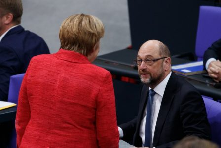 epa06341686 German Chancellor Angela Merkel (L) of the Christian Democratic Union (CDU) and Martin Schulz of the Social Democratic Party (SPD) speak with each other during a session of the German 'Bundestag' parliament in Berlin, Germany, 21 November 2017. The German Bundestag gathered for the second time in the new legislative term.  EPA/H. JEON