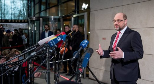 epa06422089 Leader of the Social Democratic Party (SPD), Martin Schulz makes a statement at the Social Democrats (SPD) party headquarters Willy-Brandt-Haus in Berlin, Germany, 07 January 2018. The leaders of CDU, CSU and SPD parties hold exploratory talks at the parties' headquarters through 11 January.  EPA/HAYOUNG JEON