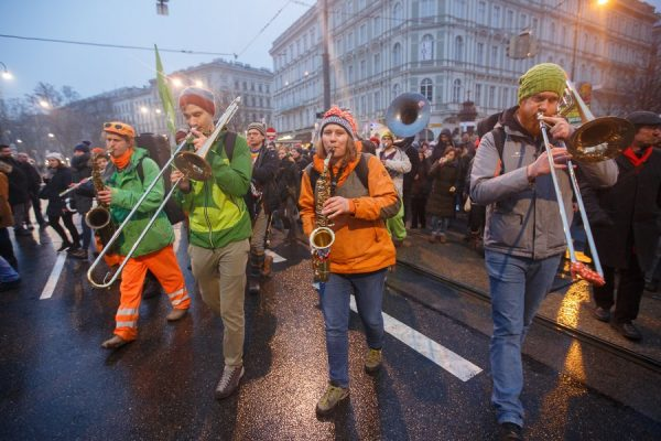 epa06436256 A marching band perform during a protest against the new coalition government between Austrian Peoples Party (OeVP) and the right-wing Austrian Freedom Party (FPOe) in Vienna, Austria, 13 January 2018. About 20,000 people took part in the demonstration organized by NGOs, refugee initiatives, political and civic organizations to protest against racism and social cuts of the new Austrian government. EPA/FLORIAN WIESER