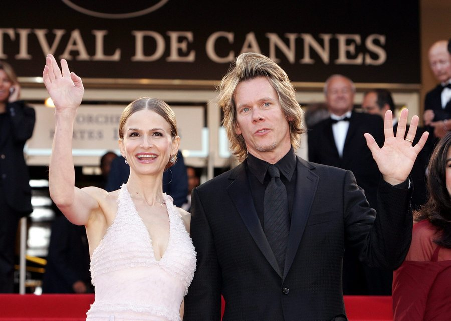 "epa00192871 US actor Kevin Bacon and his wife Kyra Sedgwick arrive at Palais des Festivals for the screening of the French movie ""Comme une image"" directed by French Agnes Jaoui which competes for the Palme d'Or at the 57th Cannes Film Festival , 16 May 2004. EPA/NIVIERE-LORENVU-NIKO FRANCE OUT"