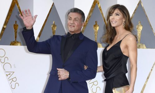 epa05186033 Sylvester Stallone (L) and Jennifer Flavin arrive for the 88th annual Academy Awards ceremony at the Dolby Theatre in Hollywood, California, USA, 28 February 2016. The Oscars are presented for outstanding individual or collective efforts in 24 categories in filmmaking.  EPA/MIKE NELSON