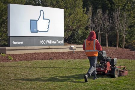 epa06301498 (FILE) - A file photo dated 31 January 2012 showing a grounds keeper mowing the lawn in front of Facebook's new Corporate Headquarters in Menlo Park, California, USA. Facebook is to report their 3rd quarter 2017 results on 01 November 2017 after markets close.  EPA/PETER DaSILVA