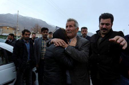 Relatives of a passenger who was believed to have been killed in a plane crash react near the town of Semirom, Iran, February 18, 2018. REUTERS/Tasnim News Agency  ATTENTION EDITORS - THIS PICTURE WAS PROVIDED BY A THIRD PARTY.