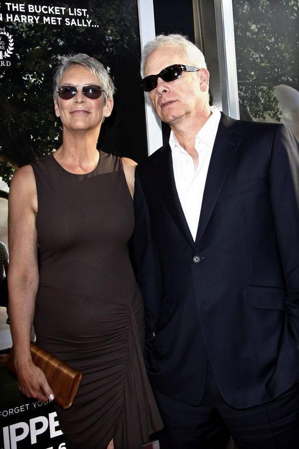 epa02262527 US actress Jamie Lee Curtis and husband Christopher Guest arrives for the USA/LA film premiere of 'Flipped' held at the Cinerama Dome in Los Angeles, USA, on 26 July 2010. The movie will be released in the USA on 06 August 2010. EPA/NINA PROMMER