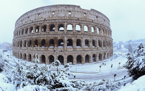 The Colosseum is seen during a heavy snowfall in Rome, Italy February 26, 2018. Picture taken with a fisheye lens. REUTERS/Alberto Lingria