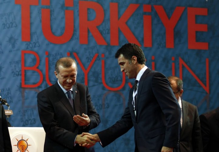 turkeys-pm-erdogan-shakes-hands-with-istanbul-candidate-hakan-sukur-during-a-meeting-to-present-his-ruling-akps-candidates-for-the-upcoming-general-elections-in-ankara