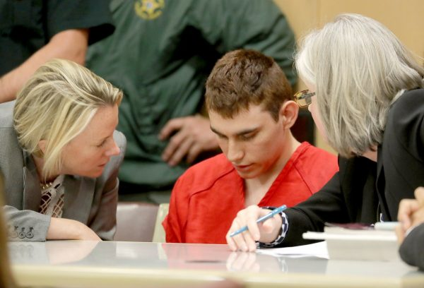 epa06543861 Nikolas Cruz (C) appears in court for a status hearing before Broward Circuit Judge Elizabeth Scherer in Fort Lauderdale, Florida, USA, 19 February 2018. Cruz is facing 17 charges of premeditated murder in the mass shooting at Marjory Stoneman Douglas High School in Parkland, Florida. EPA/MIKE STOCKER/ POOL